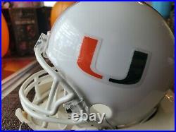 Jim Kelly Miami Hurricane signed #12 mini riddell helmet